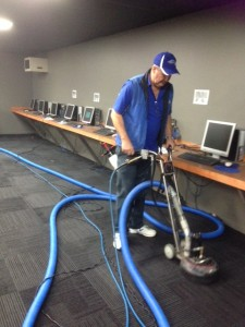 Phil using heavy duty carpet cleaning equipment